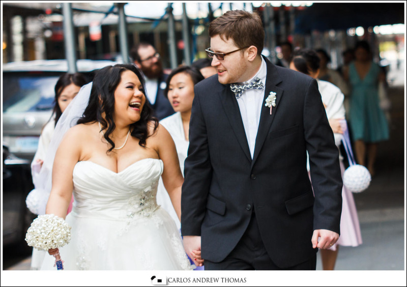 bride and groom walk on streets of new york
